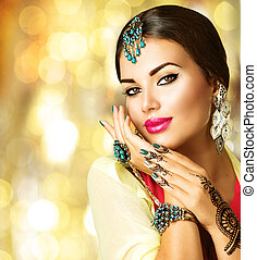 Indian girl with black henna tattoos and beauty jewels