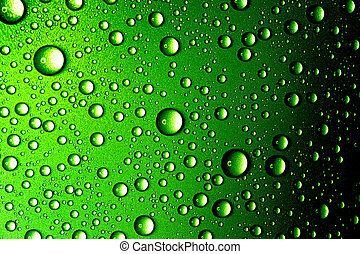 Water drops closeup Abstract green background