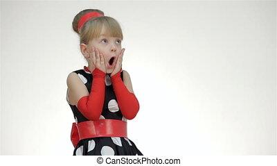 Kid girl surprised looking at copy space