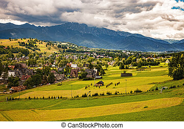 Rural landscape - View on the High Tatra Mountains with dark...