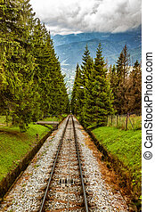 Tracks in mountain - Railroad tracks for mountain lift on...
