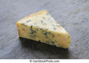 stilton cheese wedge - slice of traditional stilton cheese