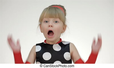 Kid girl screams Posing in studio isolated on white...