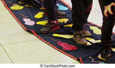 Children playing on fabric - Game Twister and all children