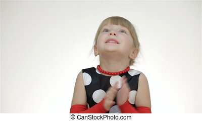 The little girl slams. Kid girl posing in studio isolated on...
