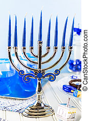 Hanukkah - Table set with cocktails and chocolates to...