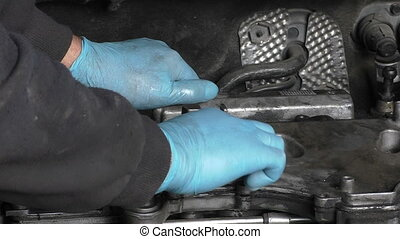 Disassembling diesel engine - Car mechanic disassembling...