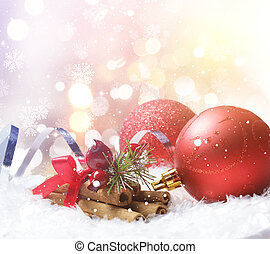 Christmas background of decorations nestled in snow -...