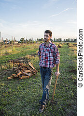 Woodcutter - Lumberman cuts wood with his strong axe