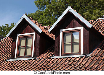 orange tiled roof and garret windows in old house, Vilnius