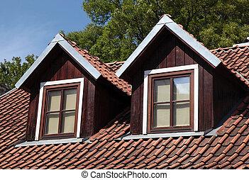 orange tiled roof and garret windows in old house, Vilnius