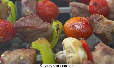 Tomato is baked on skewers kebabs, barbeque, brazier - Red...