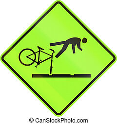 New Zealand road sign - Cyclists take care on rail tracks -...