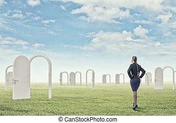 Door to new opportunity - Businesswoman standing in front of...