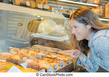 Woman choosing a patisserie