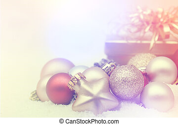 Christmas decorations nestled in snow with retro effect
