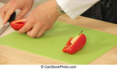 Cheff is Cutting Red Paprika on a Cutting Board HD