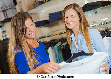 Two female friends shopping