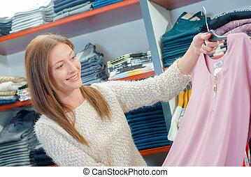 Lady choosing a jumper