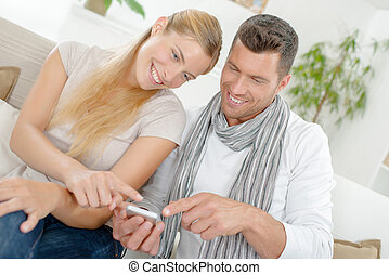 Couple laughing at a text message