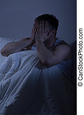 Tired man with sleep problems - Tired desperate frustrated...