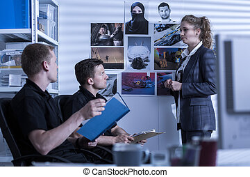 Detective at work - Female detective is talking about crime...