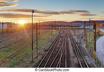 Cargo Train platform at sunset. Railroad