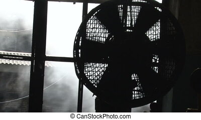 The fan and the smoke outside the window - The process of...