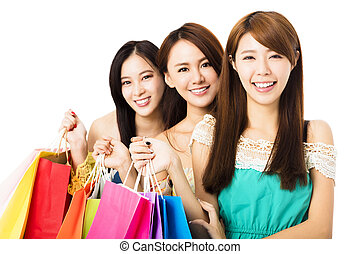 Group of happy young woman with shopping bags
