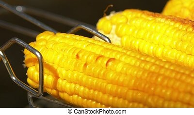 Healthy vegetarian barbecue with ripe golden corn on coals...