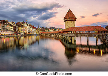 Wooden Chapel Bridge and Water Tower on sunset, Lucerne,...