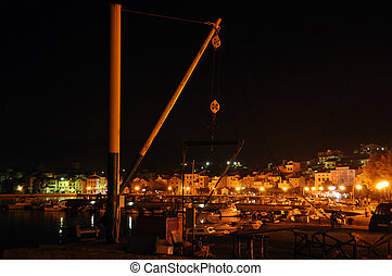Croatian marina at night - Moored boats with harbour crane...