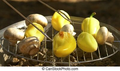 Mushroom, pepper grilling on a barbecue, turn using barbeque...