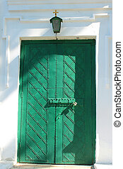 Church doors - closed green church doors and small lantern...