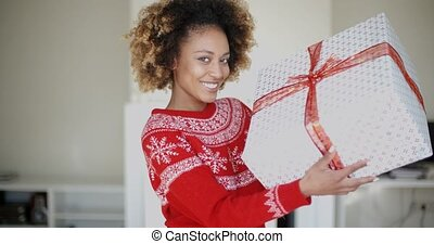 Happy Smiling Girl With Afro Haircut Holding Gift - Happy...