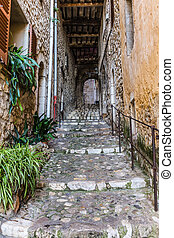 Narrow street in the old village France - Narrow cobbled...