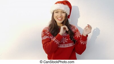 Beautiful Girl in Santa Hat and Red Woolen Sweater