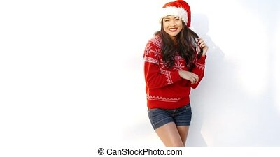 Beautiful Girl in Santa Hat and Red Woolen Sweater She...