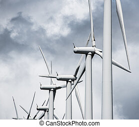 Wind power plant - Turbines of wind powered plant on hilltop...