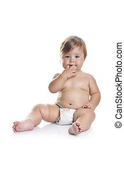 Adorable baby boy sitting with fingers in his mouth on a white background