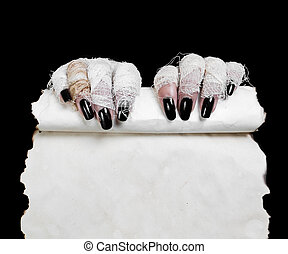 Halloween mummy hands with list - Mummy in hands keeps old...