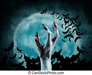 Dead Mans hand - Hand of vampire on background of full moon...