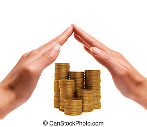 Money saving concept - Womens hands preserve coins on a...