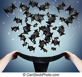 Halloween magic - Halloween origami bats fly out of the hat