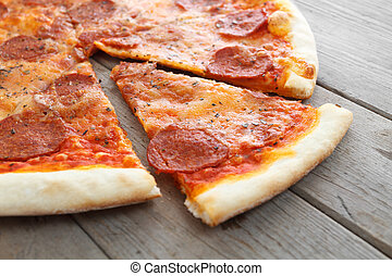 Appetizing slice of pizza - Tasty of pizza on a wooden table