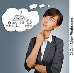 Businesswoman thinks about home - Young businesswoman thinks...