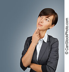 Businesswoman thinking - Young woman in a suit thinking...