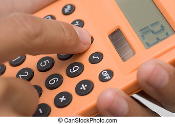 calculating - Business man use calculating machine with...