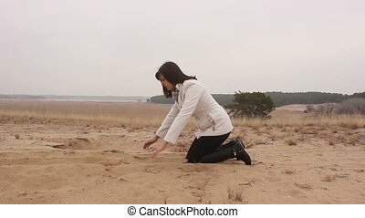 photographer takes pictures as a woman pours sand on the...