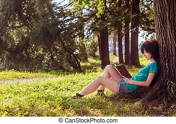 Girl reading in the nature - Attractive girl reading a book...
